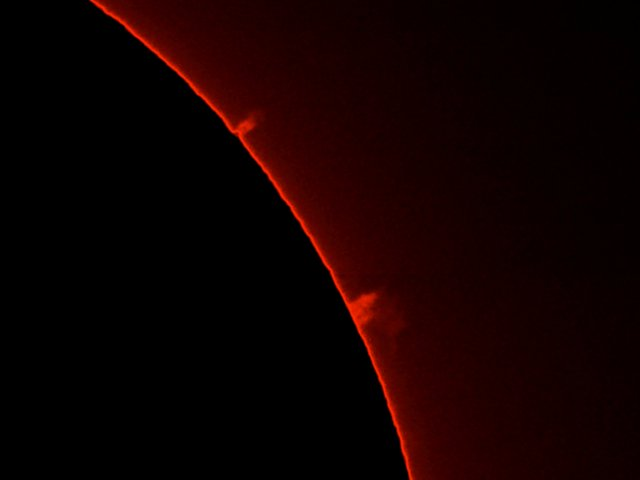 A solar prominance seen throuh a Hydrogen-alpha (H-a) filter.  The solar disc has been masked to enhance the prominance.