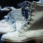 Once black combat boots now painted white, set against a black field and displayed in the Carlsen Center represented the 89 (44 in Missouri and 25 in Kansas) Iraq and Afghanistan war era vets who committed suicide between 2002 and 2009.