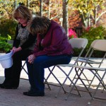 Berni Freeman (left) and Donna Wallace bow their heads during the nationwide moment of silence Nov. 11 in honor of those who gave their lives during the Iraq and Afghanistan war. Photos by Hannah Hunsinger.