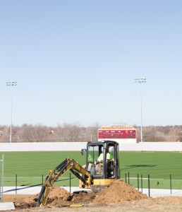Construction workers were still working on the college's baseball field through January. New lights have been installed, in addition to replacing the grass field with turf. Photo by Mackenzie Gripe