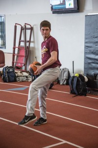Matt Ham practices with a teammate tossing a medicine ball to build up strength for future games. Photo by Andrew Shepherd