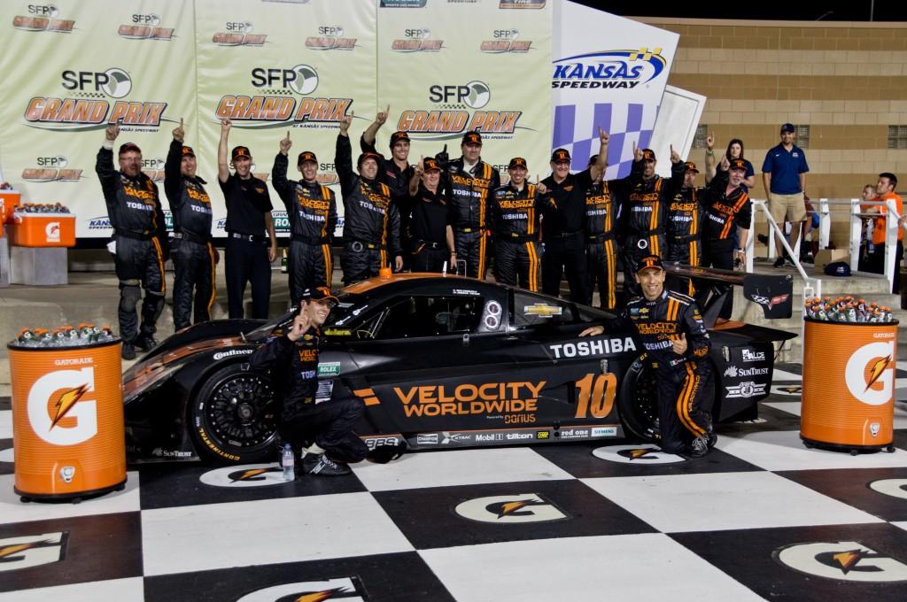 Jordan Taylor, Max Angelelli and their team celebrate in Victory Lane.