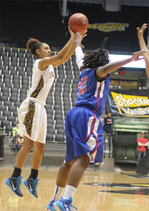 Alexis Brown shoots from beyond the arc against Kansas City Kansas at the regional championship. The Cavs would go on to win and advance to nationals 70-51.  Photo by James Howey