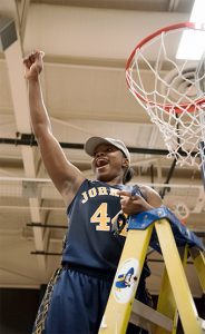 Tournament MVP Nieka Wheeler holds up a piece of the winning game net. Wheeler is currently undecided on where she will play basketball next year, but she plans on going on to Division I. Photo by Julia Larberg