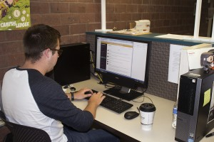 Cade Webb, managing editor, communicates with Student News Center colleagues via Slack, a communication app that utilizes aspects of social media to help teammates keep in contact.