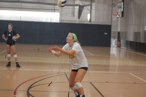 Volleyball player Michelle Tennant works on a drill during practice. The Cavaliers open the season at home on Friday, Aug. 21, in the JCCC Tournament. Photo by James Howey