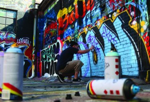 Dillion Herd (Student and Graffiti artist) begins his creation by cutting in the main backdrop for his piece. Herd met up with The Campus Ledger staff on Saturday, Sept 26, 2015 to demonstrate the process.